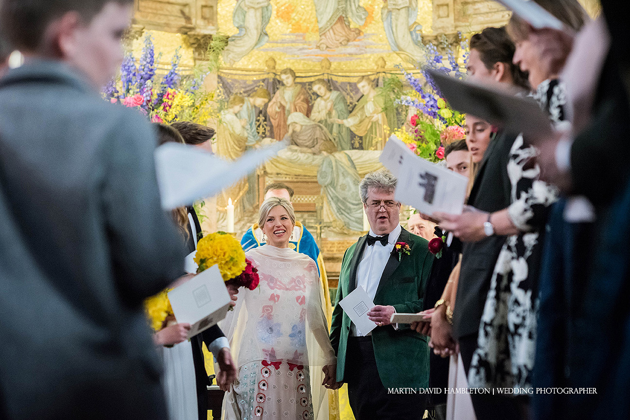wedding photography at capesthorne hall hymn singing in the chapel