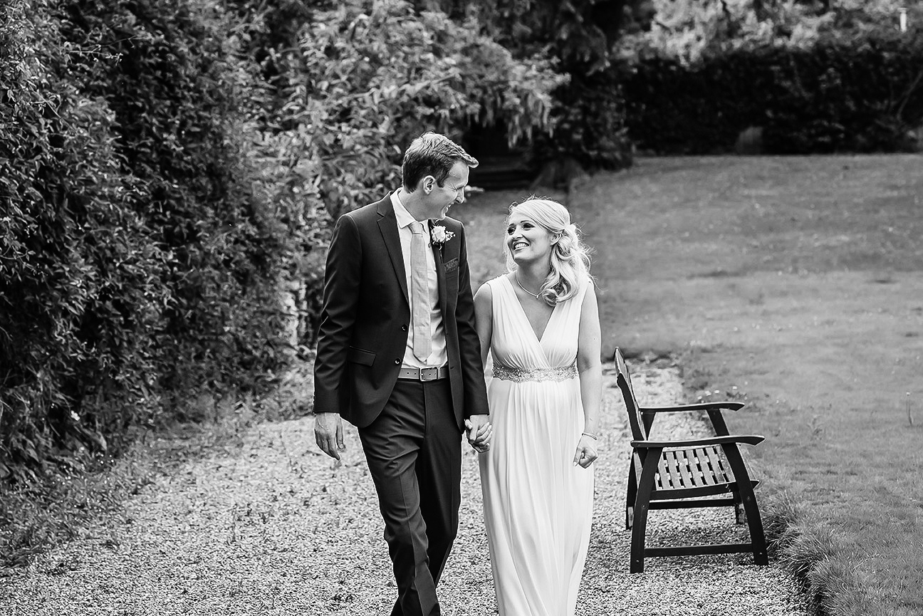 relaxed black and white portrait of bride and groom