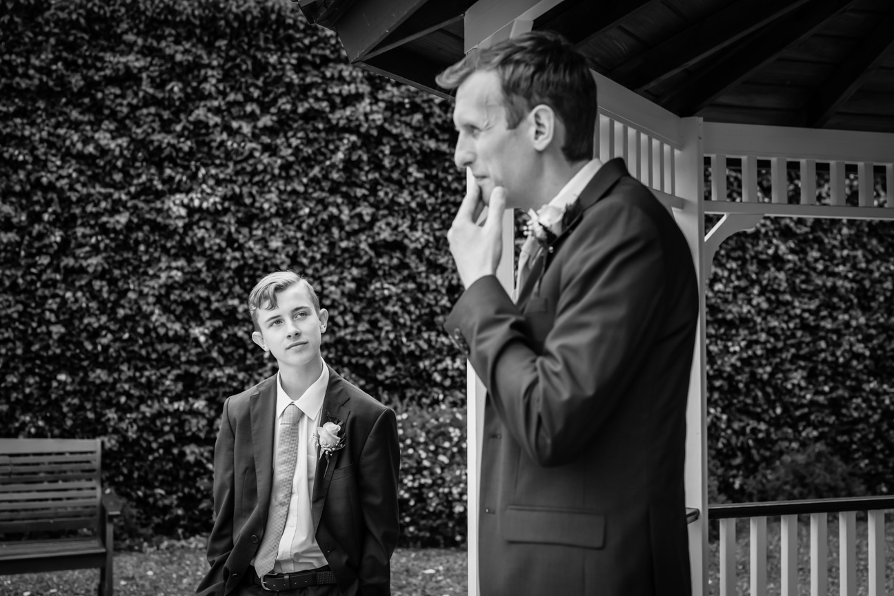 pensive groom and his younger brother