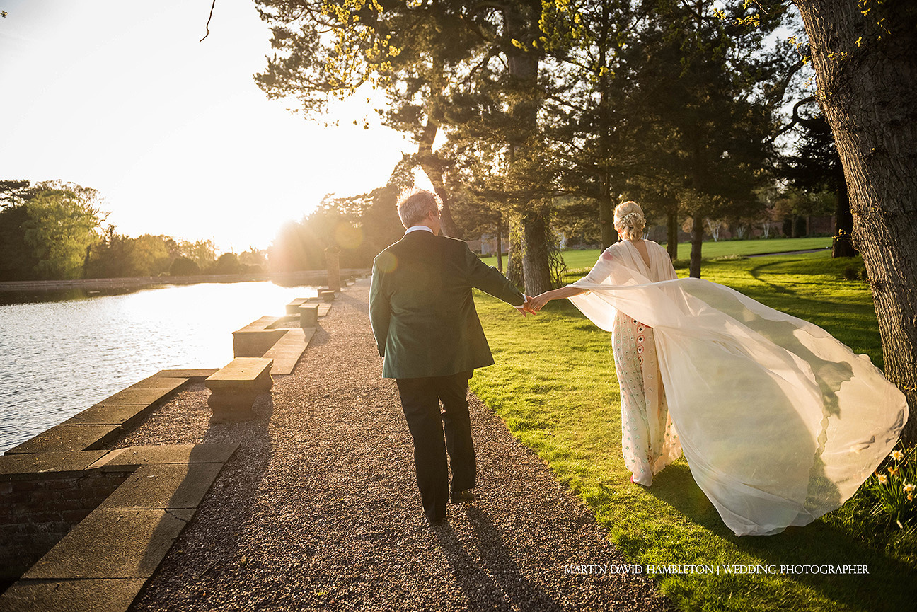 bride and groom portrait by the lake at capesthorne hall