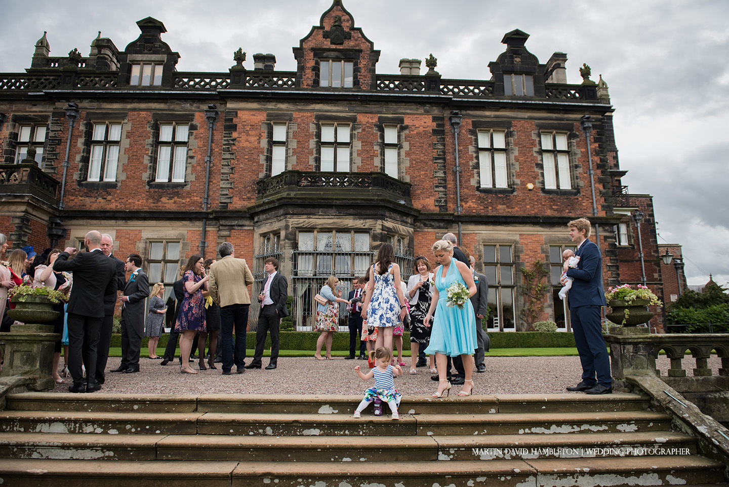 wedding guests of rear terrace of capesthorne hall