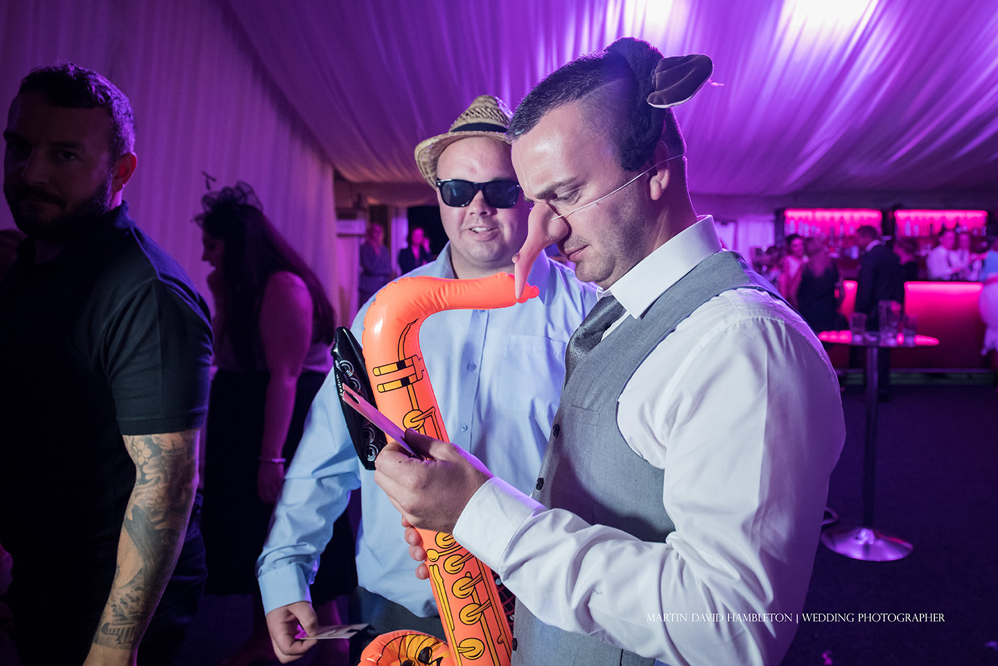 wedding guests in fancy dress for Photo Booth